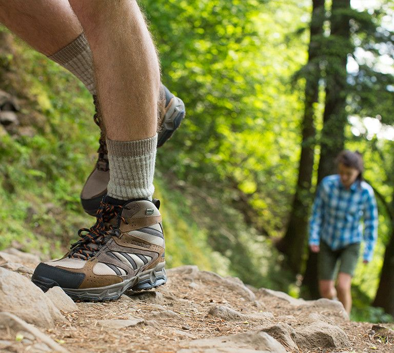 Picture of trail hiking footwear on a trail path.