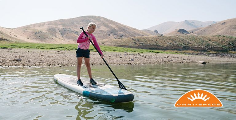 A girl on a stand-up paddleboard.