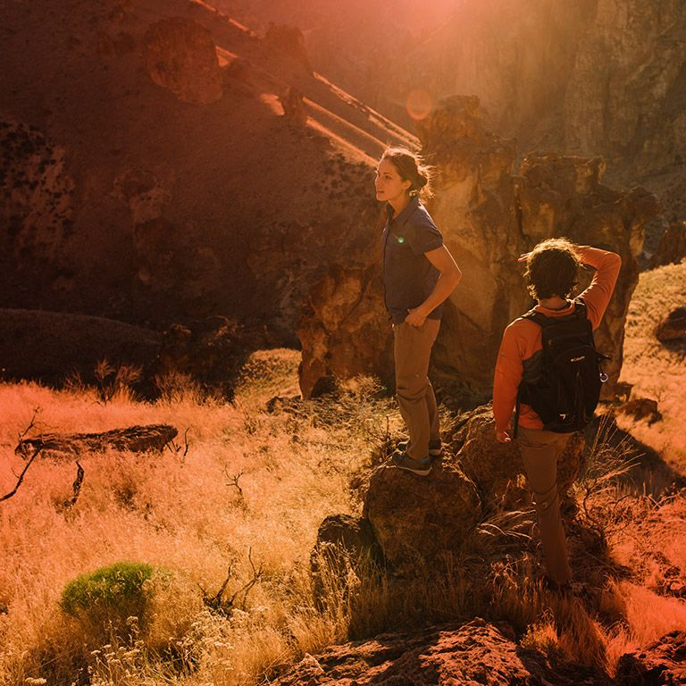 00d190aebb A man and woman hiking under the hot sun. What Sun