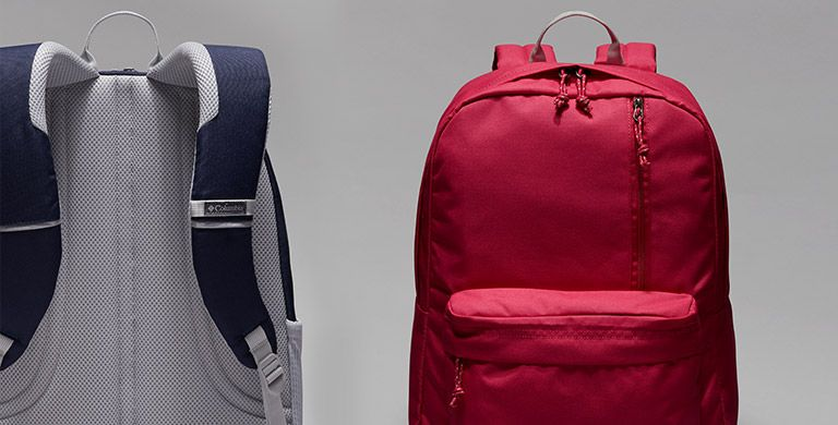 Two backpacks, side by side.