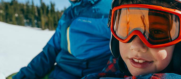 Close-up of a child wearing ski goggles.