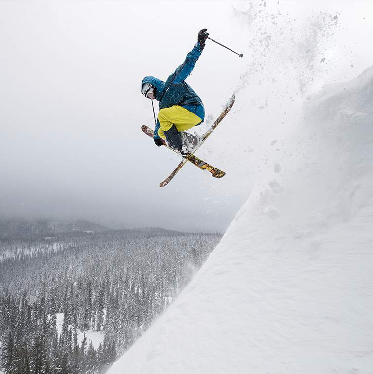 A skier jumping in mid-air.