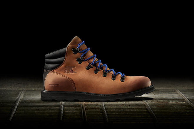 Image of an elk brown Madson Hiker boot with an urban spotlight background