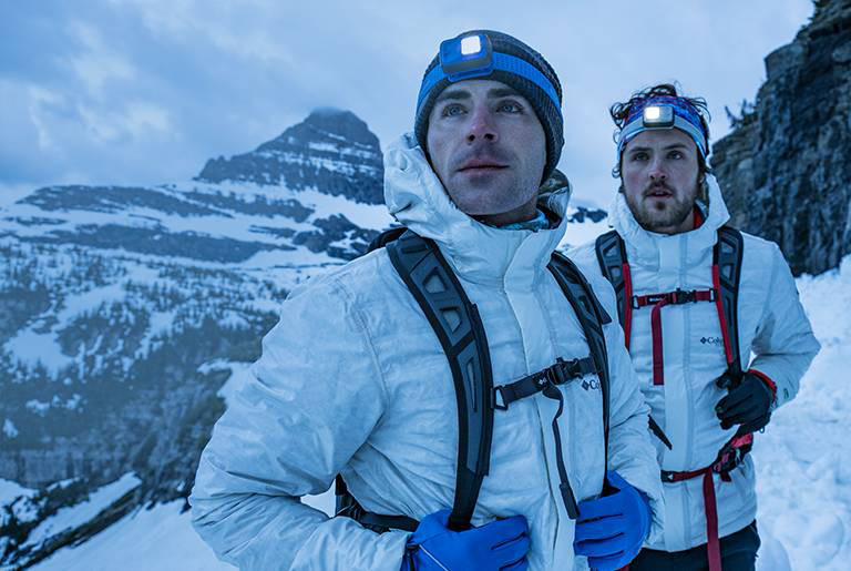 Zac and Dylan Efron wearing OutDry Ex Eco Down Jackets in Glacier National Park.