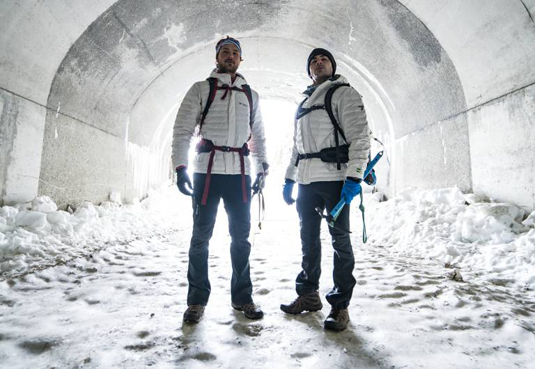 The Efrons in Eco jackets inside a snowy tunnel.