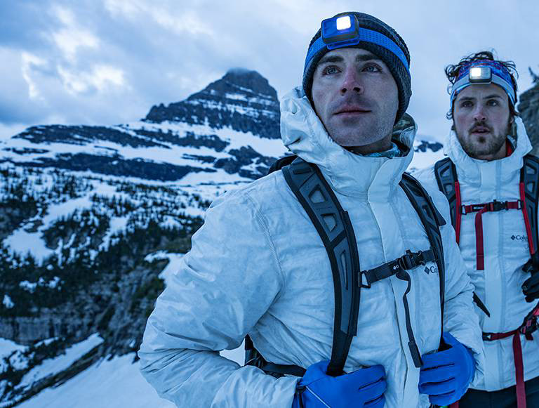 Zac and Dylan Efron stand mountainside in Glacier National Park, video link.