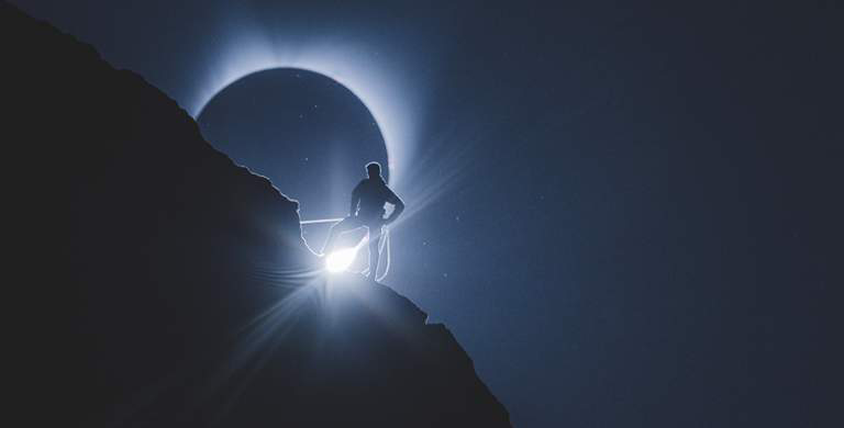 A climber silhouetted against the eclipse, video link.