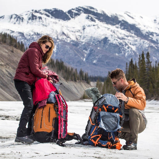 Justin and Chrishell Hartley pack up their gear in the Alaskan wilderness.