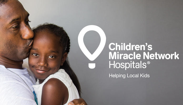 "A father embracing his daughter with overlaying text that says ""Children's Miracle Network Hospitals: Helping Local Kids."""
