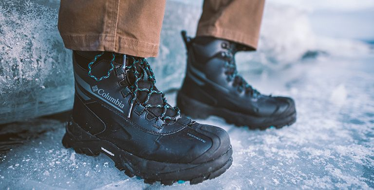 A person wearing Columbia winter boots in an icy landscape.