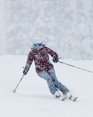 A woman wearing Columbia ski gear on the slopes.