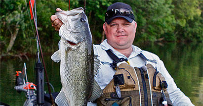 Chad Hoover holds up a catch while wearing Columbia Performance Fishing Gear.