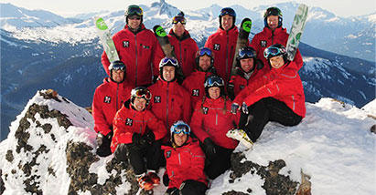 Extremely Canadian members pose for a photo in Columbia skiing gear.