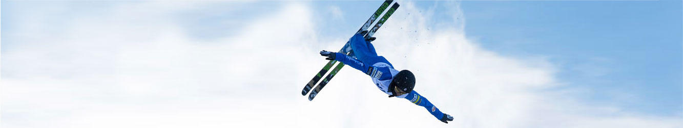 An airborne freestyle skier in Columbia gear.