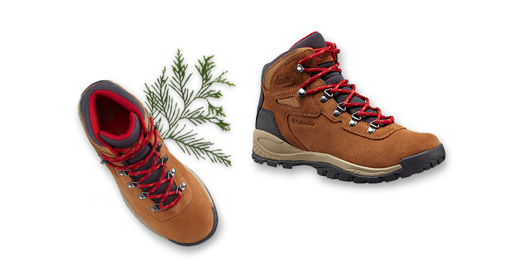 Women's hiking boots with evergreen sprig.