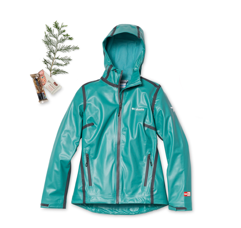 A teal rain jacket with ferns and a map.