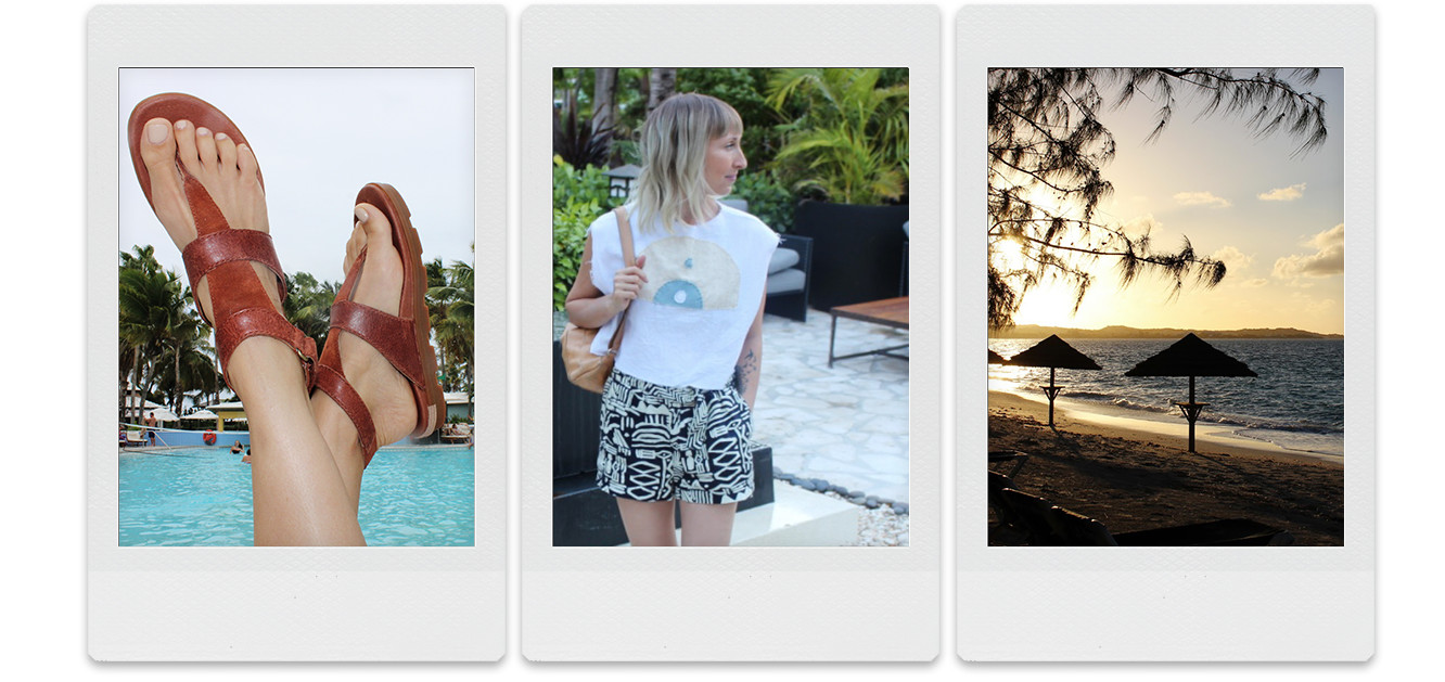 A picture of a woman's feet wearing sandals with palm trees and a pool.