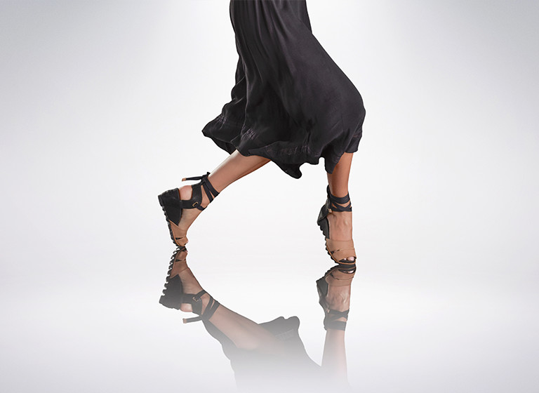 A woman dancing in SOREL wedge sandals.