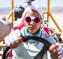 Faith at the wheel of a dune buggy.