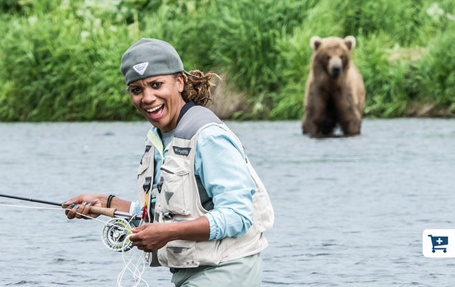 Faith reacts to a nearby bear while fishing on the Savan.