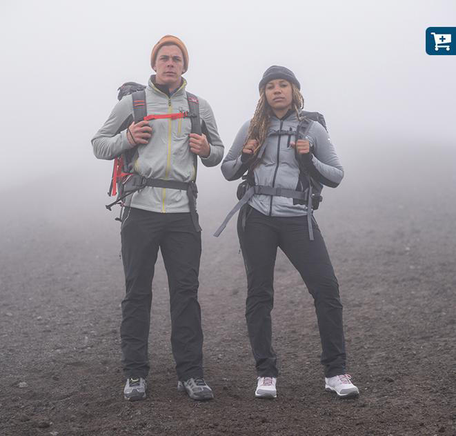 Faith and Mark stand in heavy fog as they climb Avachinsky.