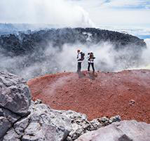 Faith and Mark peer into a crater atop the Avachinsky volcano.
