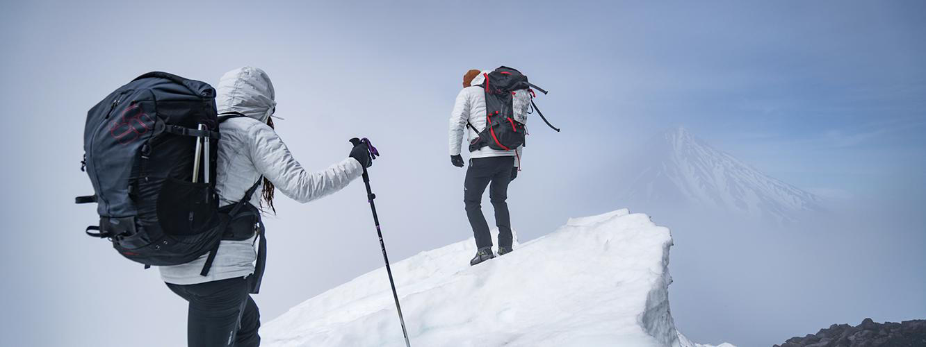 Video of the Avachinsky volcano trip. Image of Faith and Mark climbing a snowy ridge on Avachinsky.