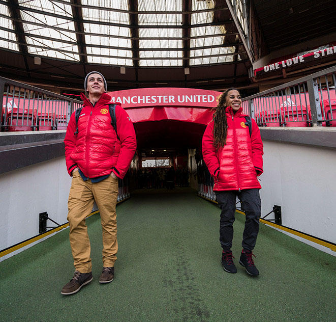 Faith and Mark walk into Manchester United's Old Trafford stadium.