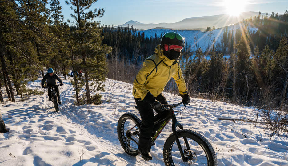 Mark and Faith pedal fat tire bikes through the snow; Video for The Give Back Yukon