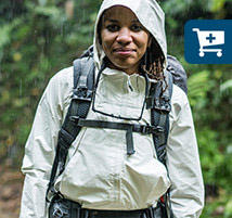 Faith wearing an OutDry Ex Eco Jacket during a downpour on the trail.