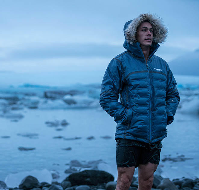 Mark stands beside a glacier lagoon in Iceland.