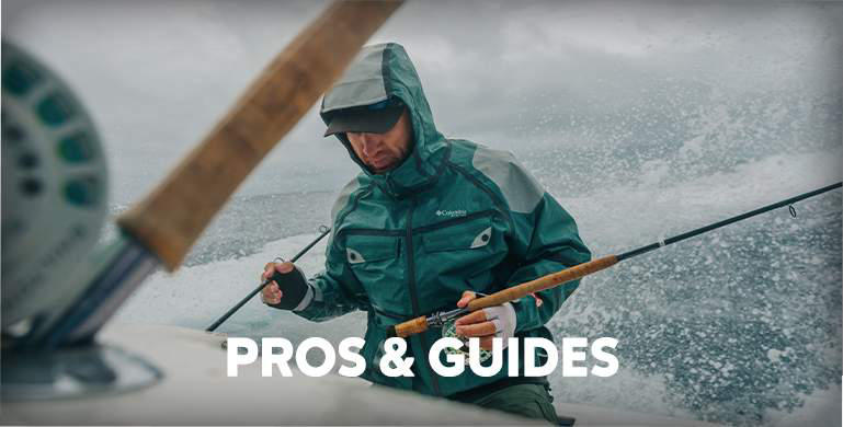A fisherman on a boat in stormy weather wearing a PFG jacket and hat popular with fishing professionals and guides.