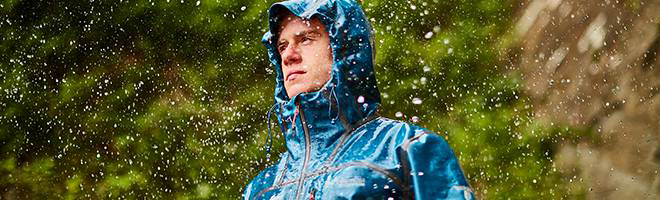 A UK National Park Ranger wearing OutDry Extreme raingear.