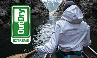 A man paddling in an earth-friendly ECO jacket.