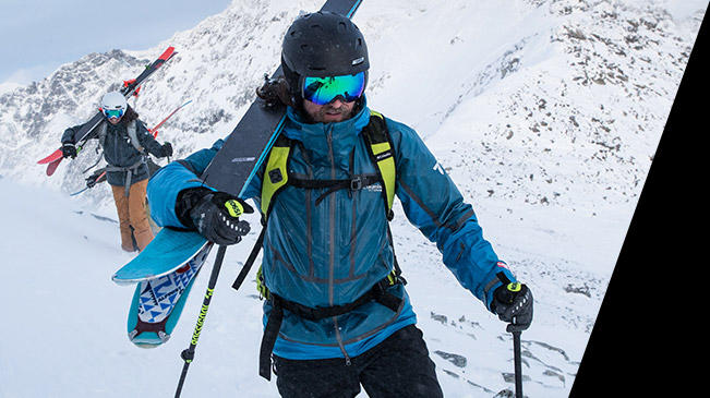 Close-up of a skier on a snowy mountain wearing a blue OutDry Ex Mogul Jacket.