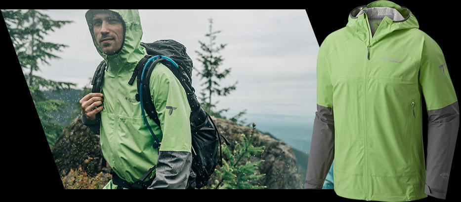 A man wearing a green and gray Trail Magic Shell Jacket hikes in the rain. Close-up of a green and gray Trail Magic Shell Jacket.