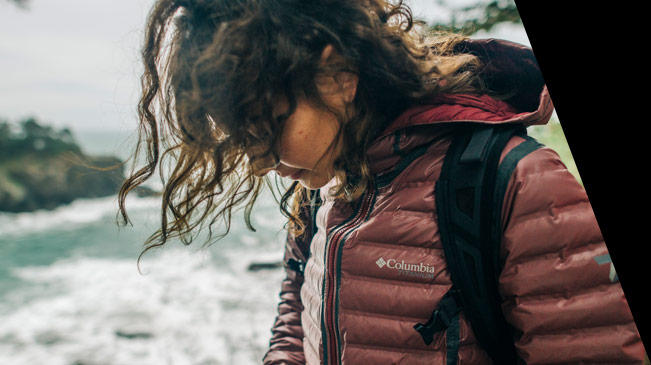 Close-up of a hiker zipping up her OutDry Extreme insulated jacket.