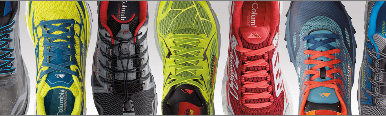 A line up of trail running shoes.
