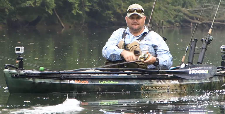 Vido still of PFG athlete Chad Hoover fishing from a kayak.