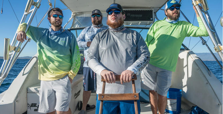 Luke Combs standing on a boat with friends.