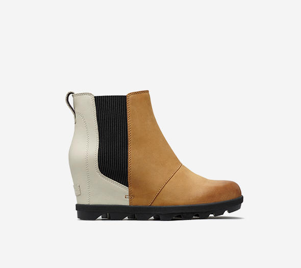 Profile view of a camel brown and white  Joan Wedge Chelsea boot