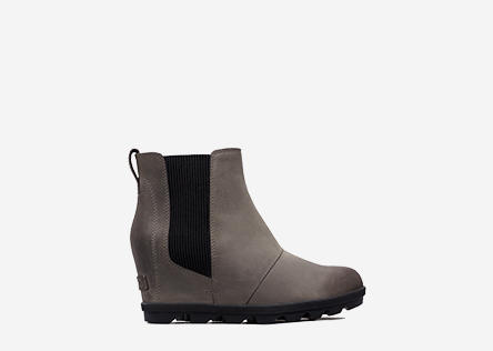 Profile view of a quarry Joan Wedge Chelsea boot.