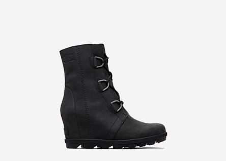 Profile view of a black Joan of Arctic Wedge II boot.