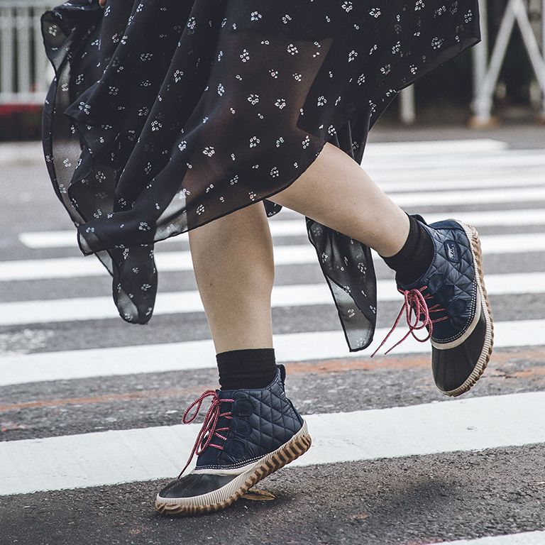 Rotating images of a woman wearing quilt Out 'N About boots around the city