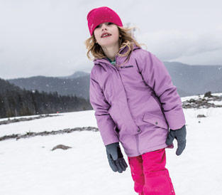 Girl playing in snow in Outgrown gear.