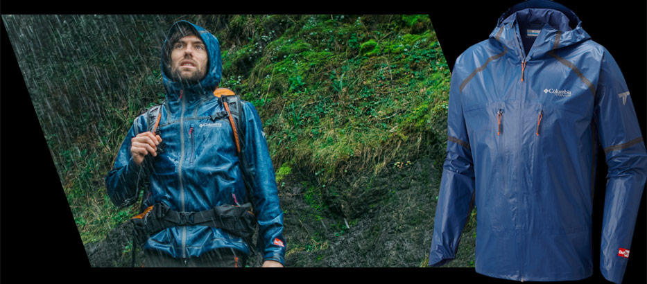 A man hiking in the rain wearing lightweight Titanium gear.