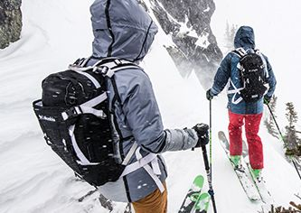 Skiers wearing Columbia outer layers on the mountain.
