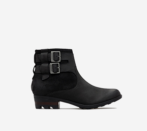 Profile view of a black Lolla Chelsea bootie