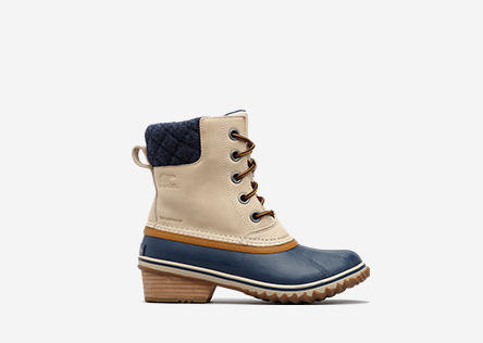 Profile image of an oatmeal and collegiate navy Slimpback II Lace boot on a white background