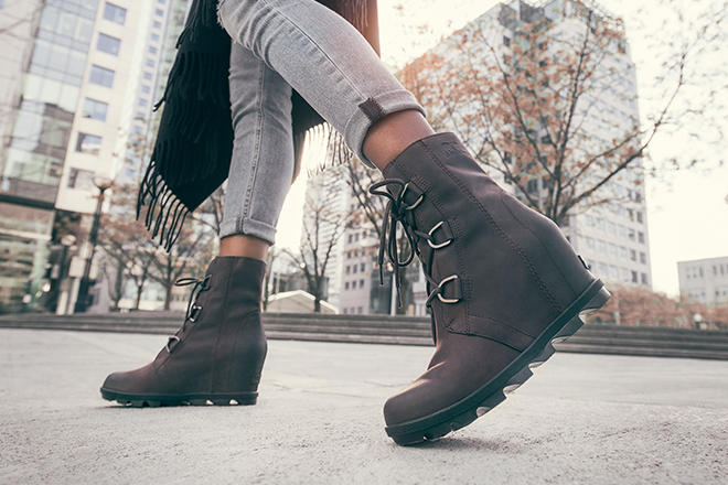 Image of a woman wearing crouton Madson Chukka boots in an urban setting
